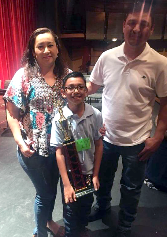 Photo of Damian Solis at the New Mexico Spanish Spelling Bee with family members